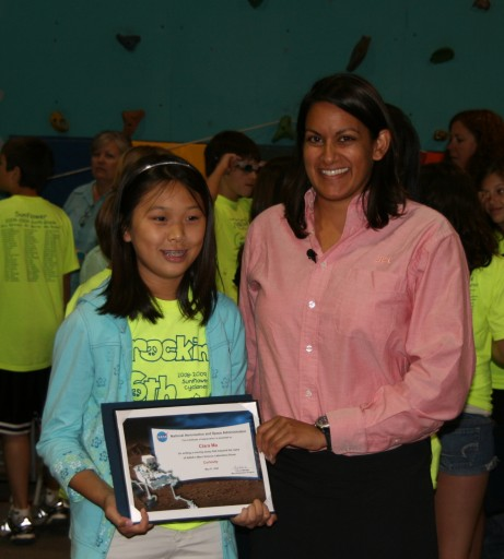 Clara Ma receives award certificate from mission engineer Suparna Mukherjee
